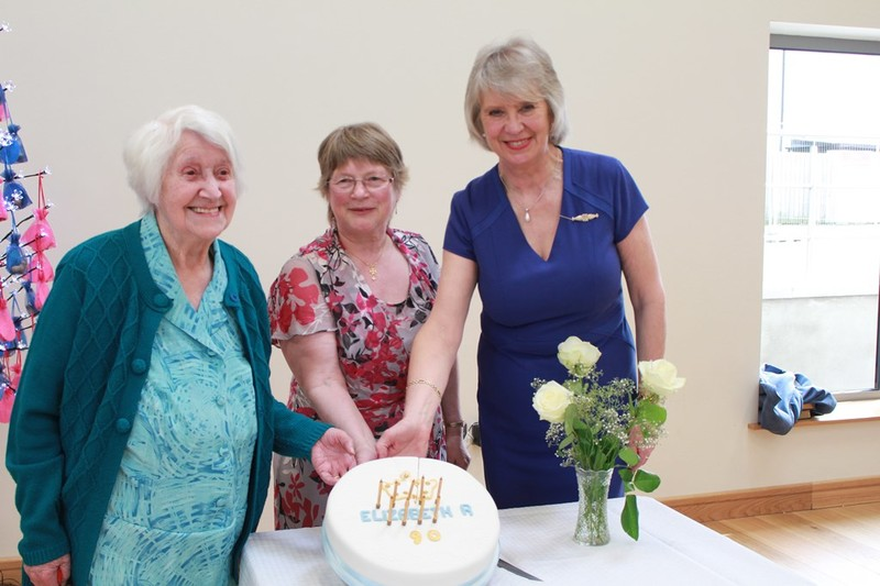 Barbara Smith Mrs Liz Miller and June Butler with the birthday cake