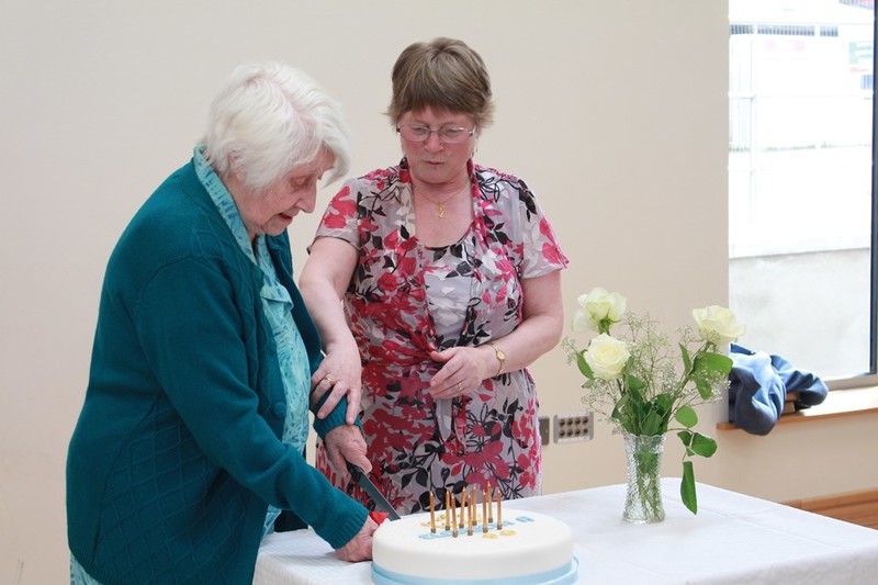 Barbara and Liz cut the cake