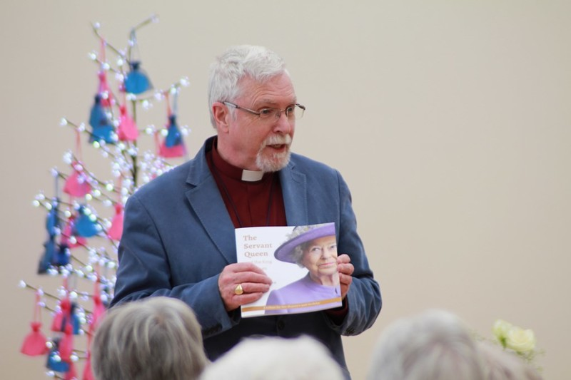 Bishop Harold presented each person with a book