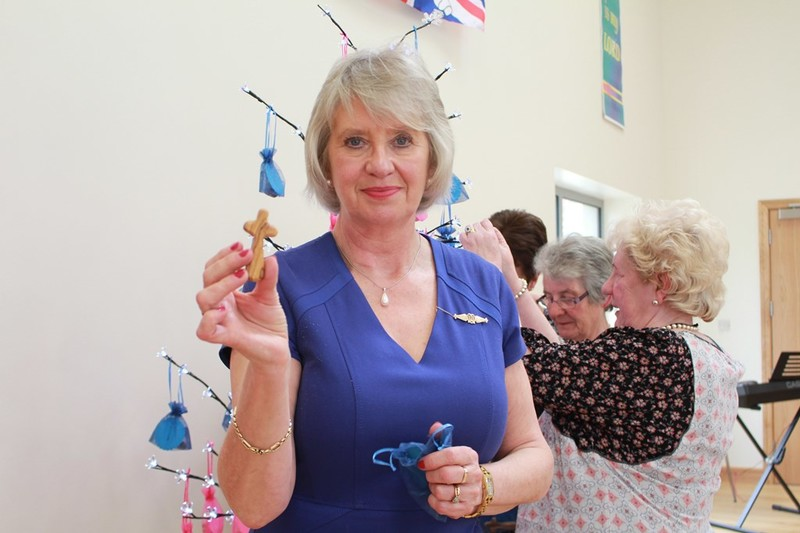 Diocesan President June Butler with one of the holding crosses