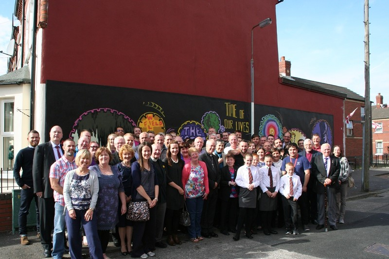 Group photo in front of Willowfield mural