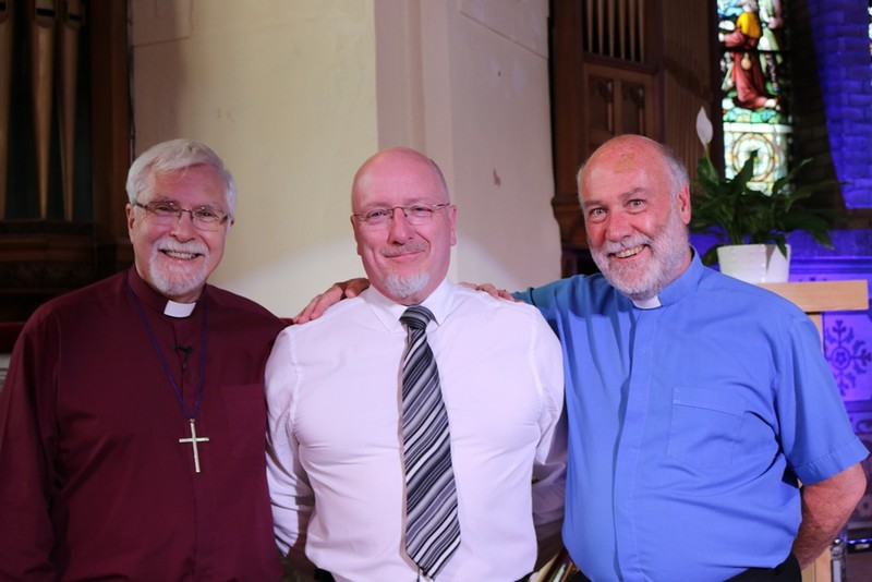 Norman with the bishop and his rector, Revd Stephen Smyth