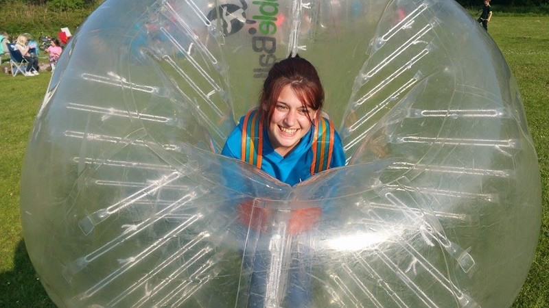 Girl in bubble football