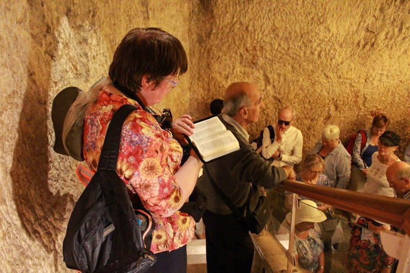 Reading scripture in dungeon at Caiaphas House