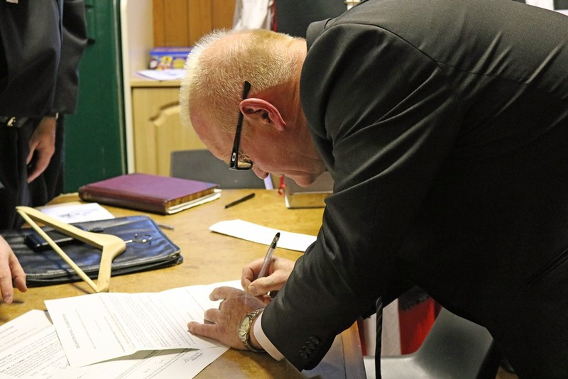 Peoples Churchwarden Brian Jenkinson signs