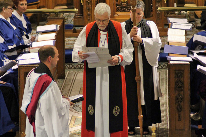 The Bishop reads the act of institution
