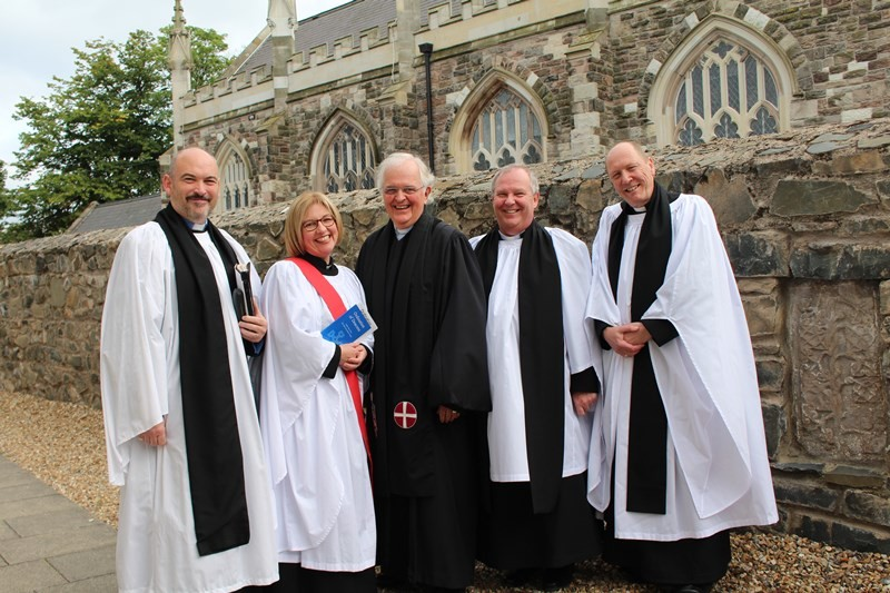 The new deacons with preacher Canon Dr Brian Fletcher