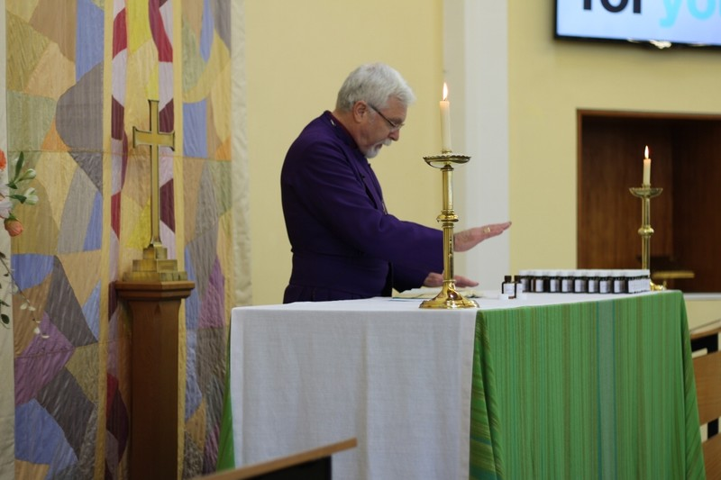 Bishop Harold consecrates the oils