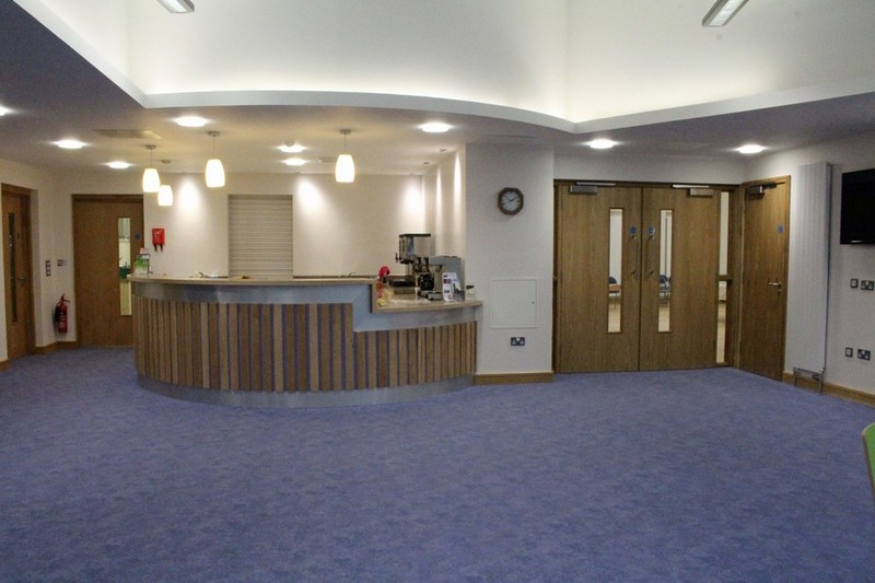 Coffee bar with hall to right office and meeting room to left
